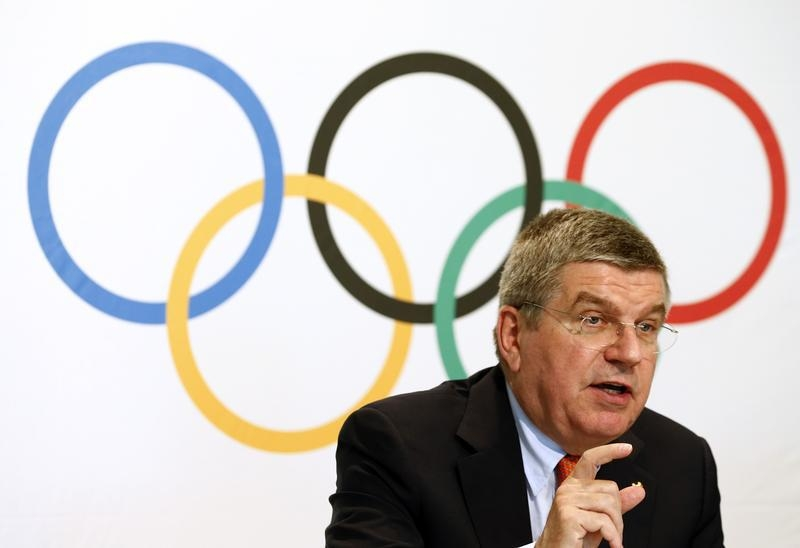 IOC President Bach gestures during a news conference after a three-day executive board meeting in Lausanne