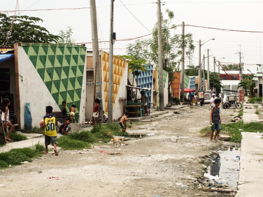 Barangay Tanza 2 is a relocation site for families affected by Bagyong Pedring. Children create playgrounds out of these cemented roads which still get flooded, especially during typhoon season.
